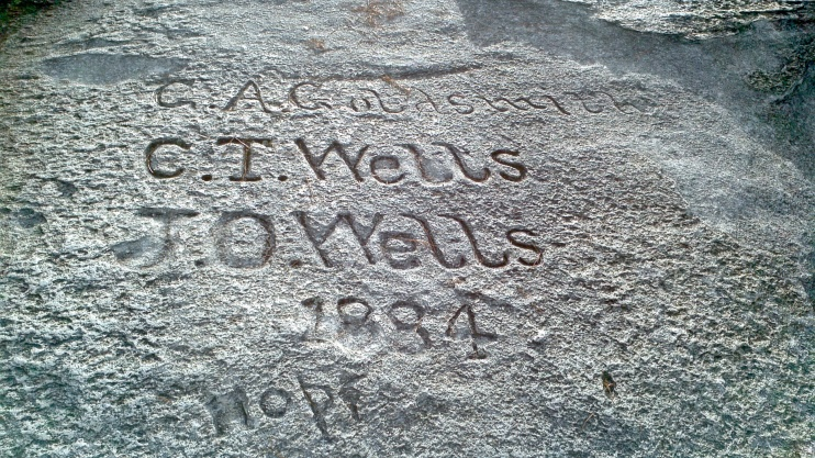 Carving on Stone Mountain, identifying G. A. Goldsmith, C. T. Wells, and J. O. Wells, dated 1884. Taken 14 October 2013, with a Motorola Camera phone.