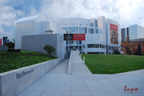 High Museum of Art, Peachtree Street, Atlanta, GA. Taken 4 September 2009, with a Nikon D60 DSLR. Edited in Photoshop to remove the tree branch in the upper left, and to add clouds from a generic cloud photo taken at another time.